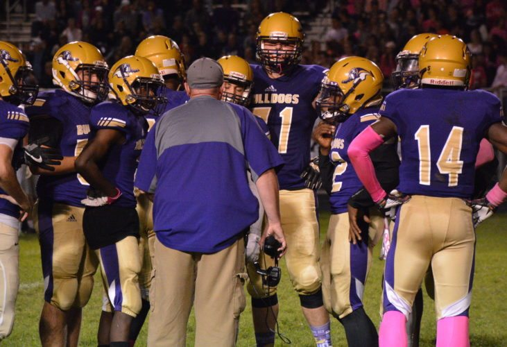 New Haven football coach Jim Rowland, middle, talks with his players during a game last season. (File photo by Reggie Hayes of news-sentinel.com)
