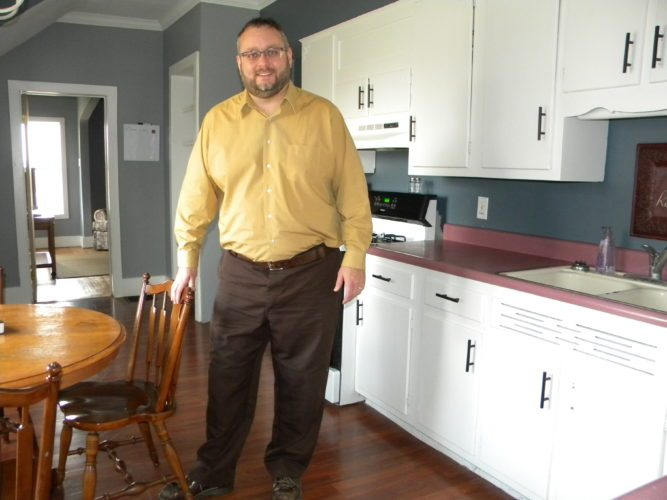 Brandon Bower stands in the kitchen of the new Life Recovery Home set to open soon on Goshen Road in northwest Fort Wayne. The home will serve men recovering from addictions. (By Kevin Kilbane of News-Sentinel.com)