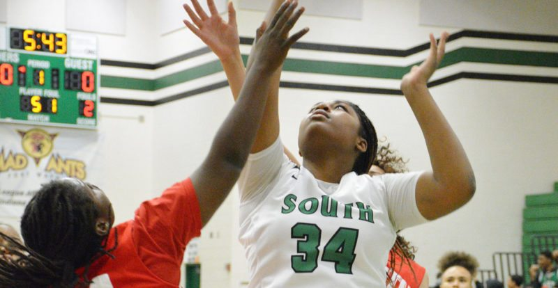 South Side senior Taniece Chapman goes up for a shot around the  defense of North Side senior Laquisha Ruth during a game on  December 8, 2017 at South Side. (Photo by Dan Vance of The News- Sentinel)