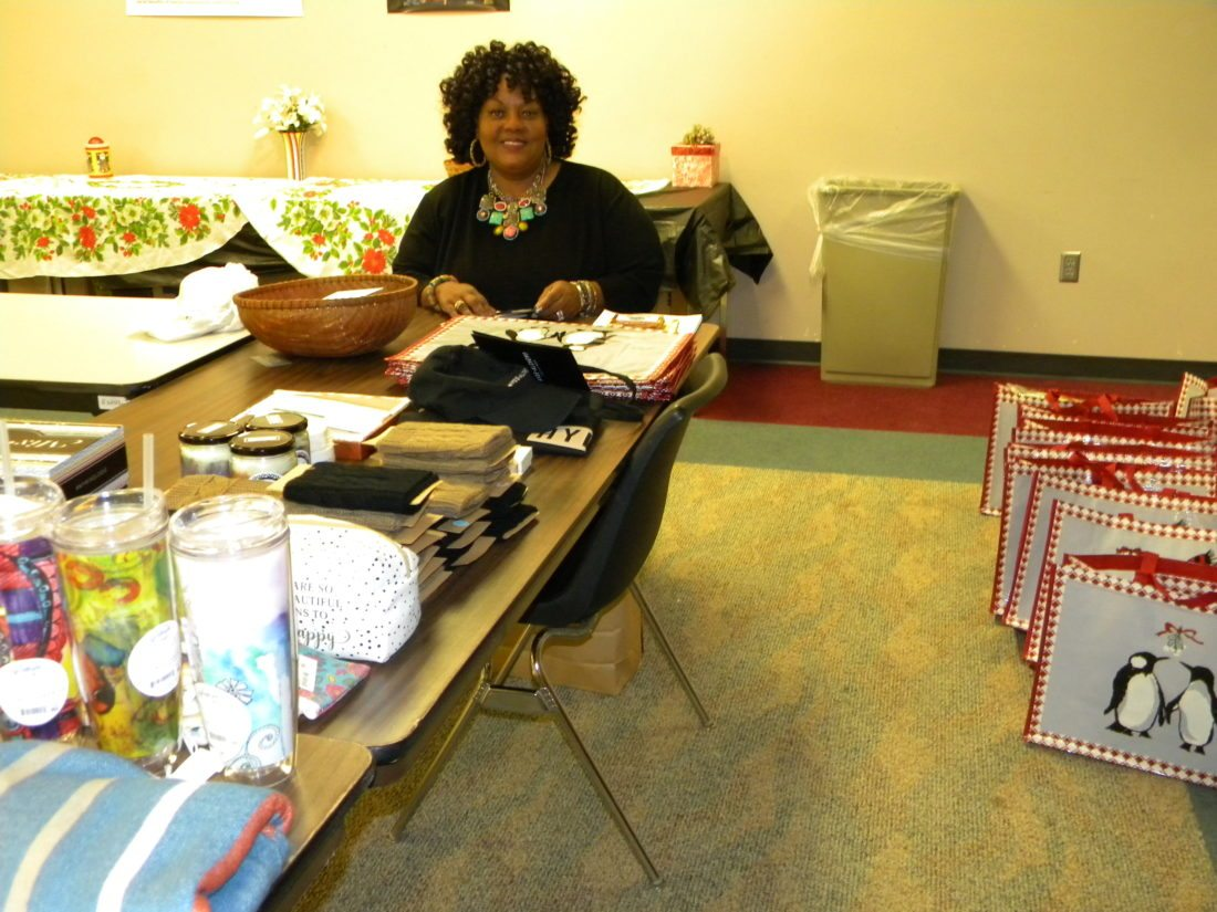 "Kathryn Mbwelera of the Fort Wayne Urban League has started packing gift bags making other preparations for the ""Christmas on the Campus"" event that will bring about 60 women from local homeless shelters and halfway houses to the Urban League offices Monday for a holiday party with games, gifts, food and more. (By Kevin Kilbane of News-Sentinel.com)"