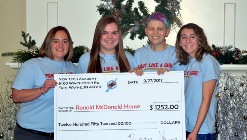 From left, New Tech Academy Director Any Oberlin, Leslie Alter, Reagan Swinford and Kara Gerber presented a check to the Ronald McDonald House at Parkview Regional Medical Center on Thursday. (By Blake Sebring of News-Sentinel.com)