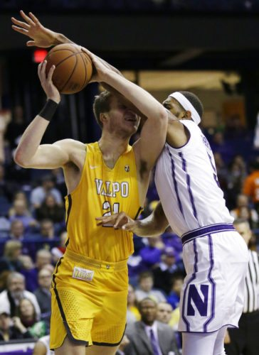 Northwestern center Dererk Pardon, right, guards Valparaiso center Derrik Smits during the first half of a game Thursday in Rosemont, Ill. (By The Associated Press)