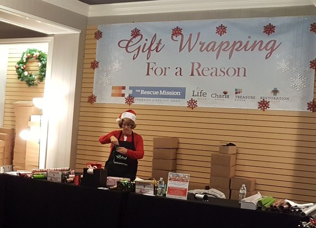 Gift Wrapping for a Reason provides free gift wrappings for customers at Glenbrook Square, across from Barnes & Noble, until Dec. 24. Donations are accepted to support the Rescue Mission's programs for the homeless. (Photo by Brad Saleik of News-Sentinel.com)