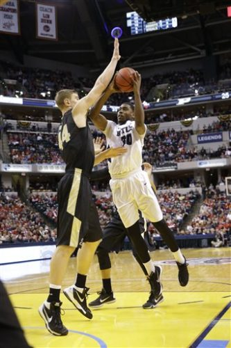 Butler forward Kelan Martin (30) shoots over Purdue center Isaac Haas (44) in the first half of a game in Indianapolis during the 2015-16 season. (By The Associated Press)