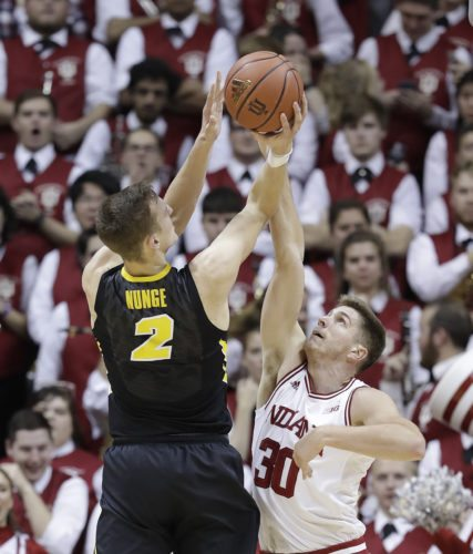 Iowa's Jack Nunge puts up a shot against Indiana's Collin Hartman during the second half of a recent game in Bloomington. (By The Associated Press)