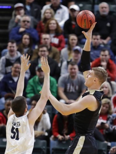Purdue's Isaac Haas (44) shoots over Butler's Nate Fowler (51) during the first half of a game, Saturday in Indianapolis. (By The Associated Press)