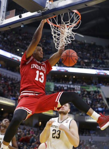 Indiana's Juwan Morgan dunks against Notre Dame's Martinas Geben (23) during the first half of a game against Notre Dame Saturday in Indianapolis. (By The Associated Press)