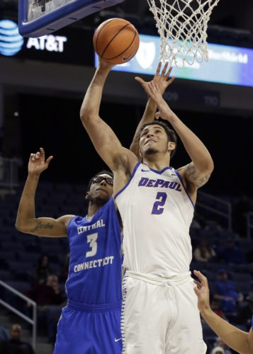 DePaul forward Jaylen Butz, right, goes up for a shot against Central Connecticut State forward Mustafa Jones during the second half of a recent game in Chicago. DePaul lost to city-rival Northwestern Saturday. (By The Associated Press)