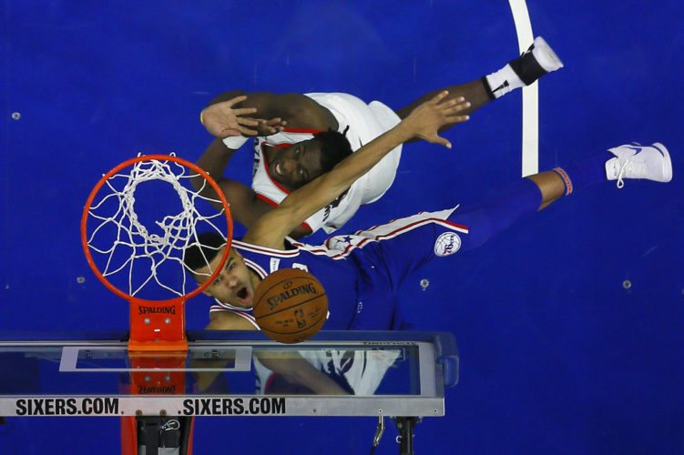 Philadelphia 76ers' Timothe Luwawu-Cabarrot, bottom, gets a shot past Portland Trail Blazers' Caleb Swanigan during the second half of a game last month in Philadelphia. (By The Associated Press)