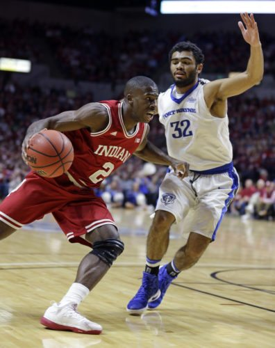 Indiana guard Josh Newkirk (2) drives past Fort Wayne guard Kason Harrell (32) in the first half of a game last season in Fort Wayne. (By The Associated Press)