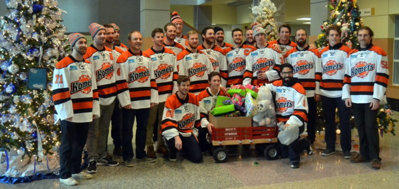 As a team, the Komets made a recent visit to Lutheran Children's Hospital to hand out presents and cheer patients. (By Blake Sebring of News-Sentinel.com)