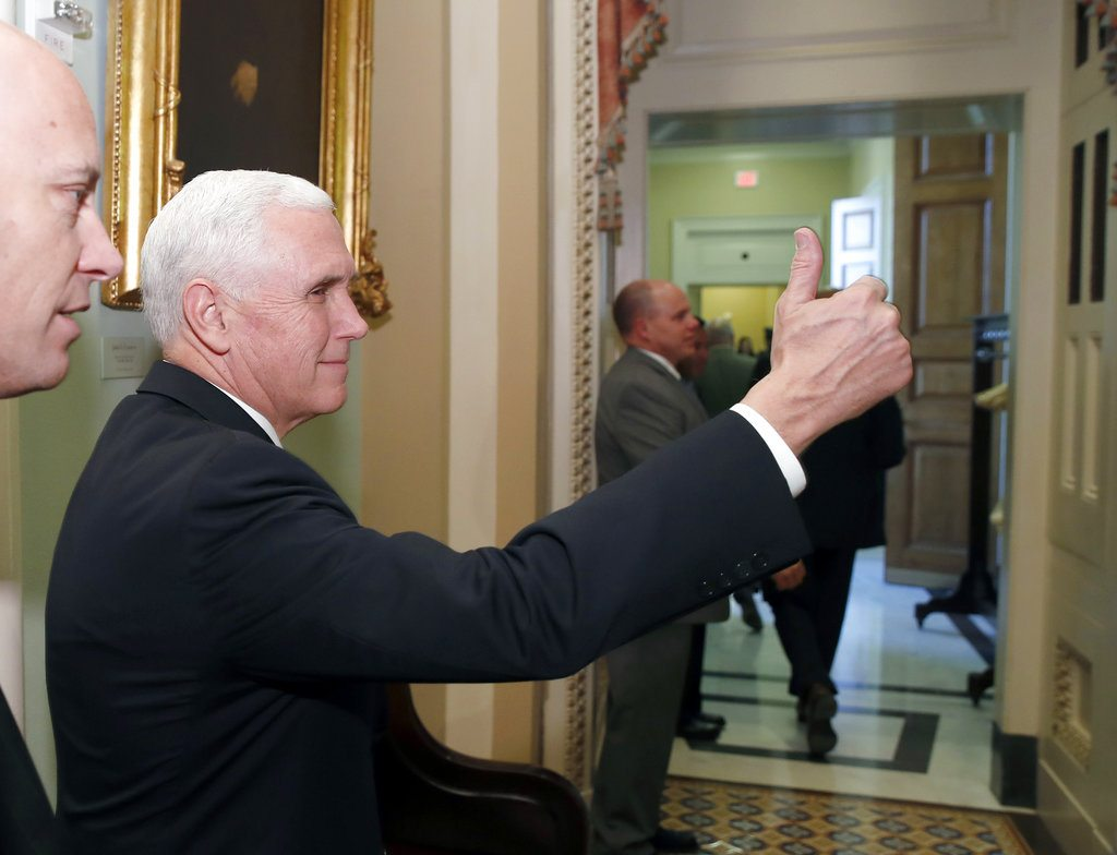 Vice President Mike Pence gives thumbs up as he enters the Senate Republican policy luncheon Tuesday on Capitol Hill in Washington. (Photo by The Associated Press)