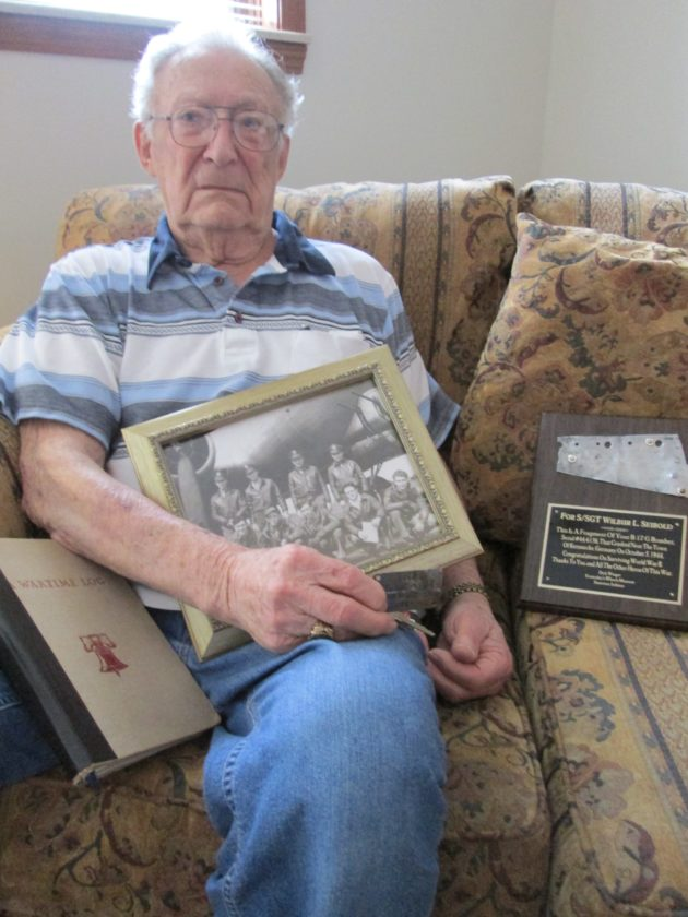 After more than 73 years since his flight crew was captured by German troops during World War II, Wilbur Seibold still values his dog tags, a photo of his flight crew and a plaque containing a piece of his downed aircraft. (Photo by Kayleen Reusser for The News-Sentinel)