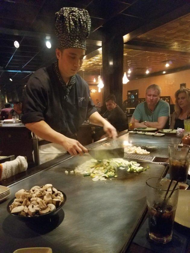 A chef prepares meals at Takaoka of Japan.