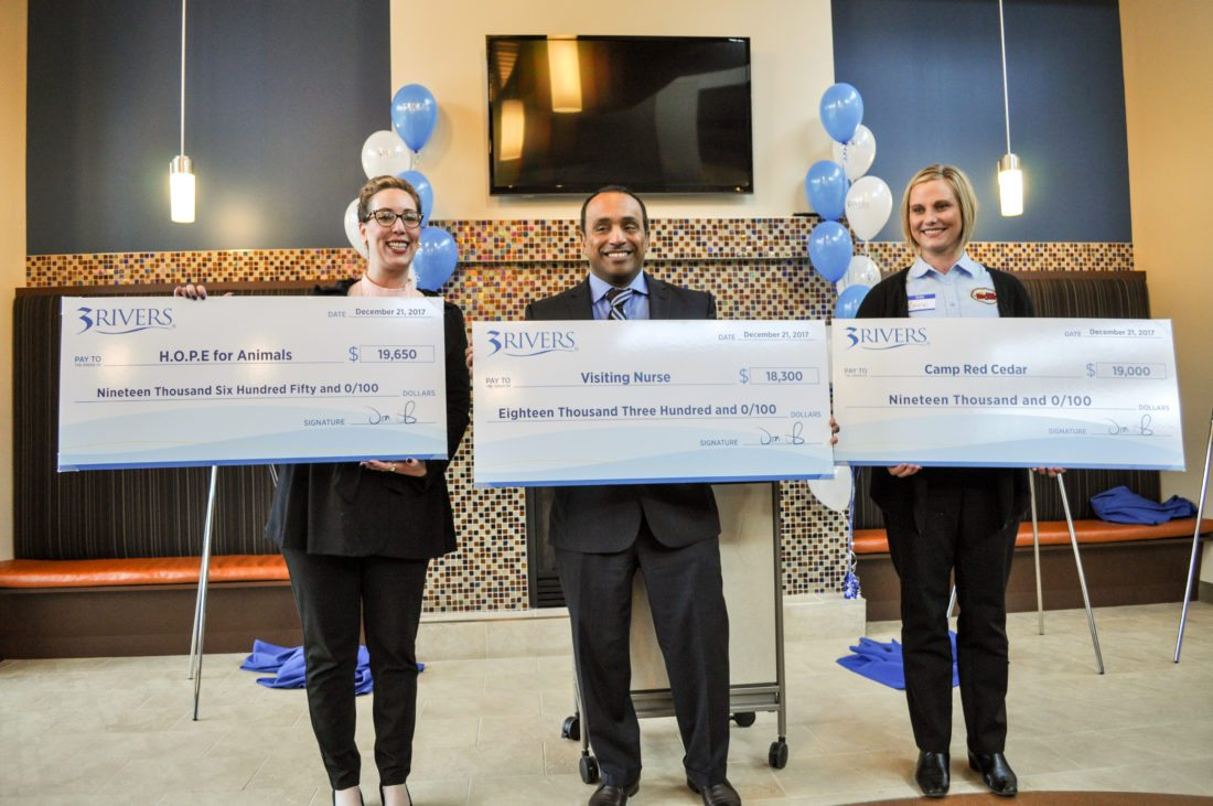 3Rivers Credit Union awarded more than $56,000 to three charities as part of its Give Back initiative.  From left are Allison Miller, executive director of  H.O.P.E. For Animals;  Eric Klimes, CEO of  Visiting Nurse, and Carrie Perry, director or Camp Red Cedar. (Photo courtesy of 3Rivers Credit Union)