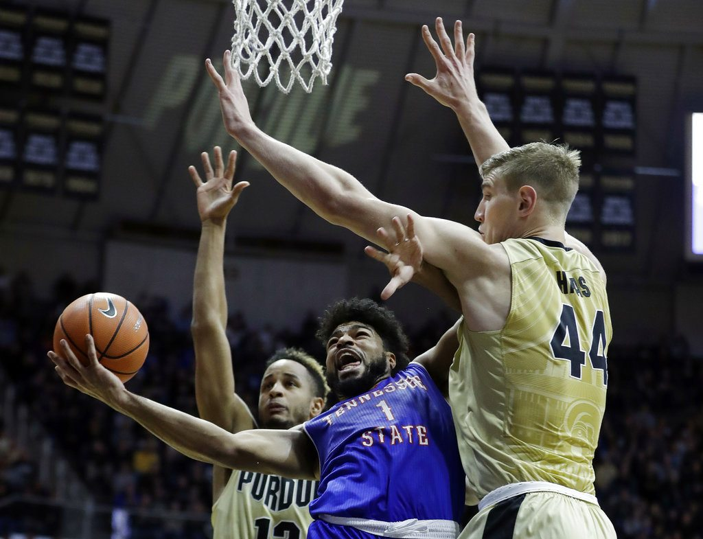 Tennessee State's Delano Spencer puts up a shot against Purdue's Vincent Edwards (12) and Isaac Haas during the first half of a game Thursday in West Lafayette. (By The Associated Press)