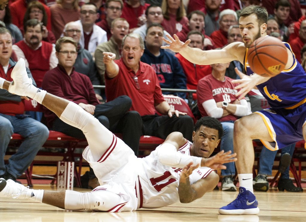 Indiana guard Devonte Green (11) passes the ball as he slides near Tennessee Tech guard Aleska Jugovic (4) during the first half of a game in Bloomington Thursday. (By The Associated Press)
