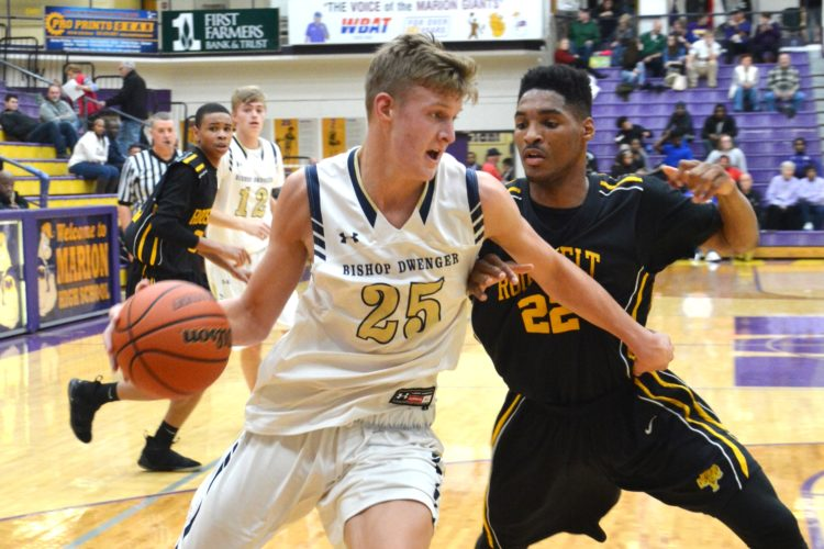 Bishop Dwenger's Lucas Lehrman works to the basket by Gary Roosevelt's Latrell Williams on Friday. (Photo by Dan Vance of news-sentinel.com)