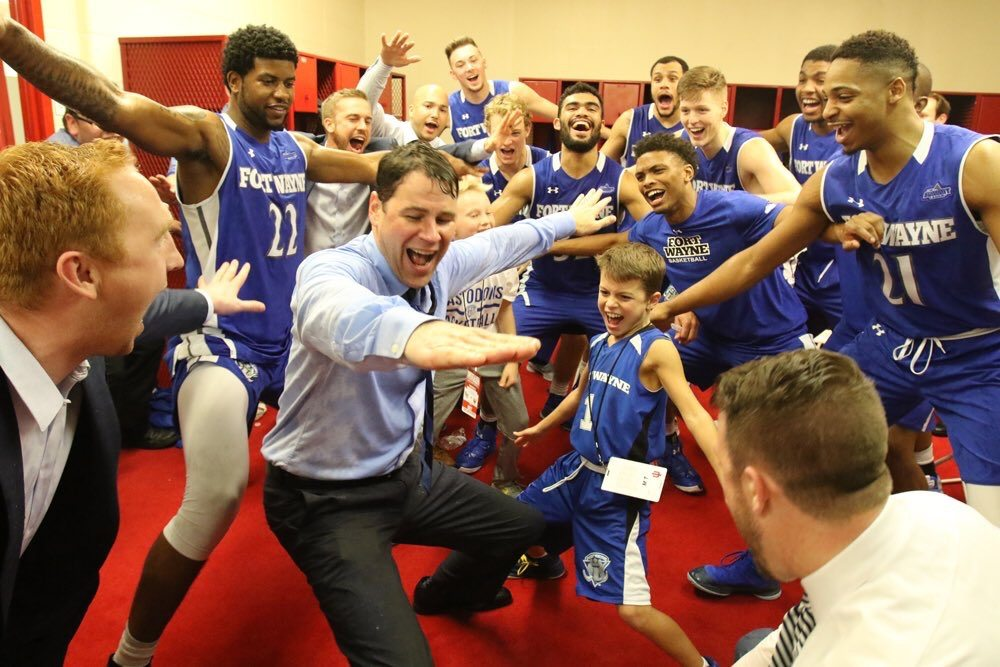 """Fort Wayne men's basketball coach Jon Coffman leads his team in a postgame ritual of """"riding a wave of positive energy"""" following his team's win over Indiana Monday in Bloomington. (Photo courtesy of Fort Wayne Athletics)"""