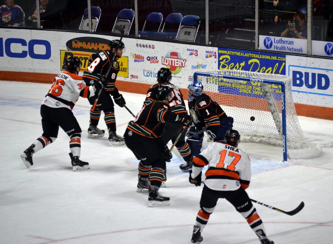 Center Logan Nelson, left, scored the Komets' first goal Saturday night by flipping the puck over Quad City goaltender Matt O'Connor on a power play. (By Blake Sebring of News-Sentinel.com)