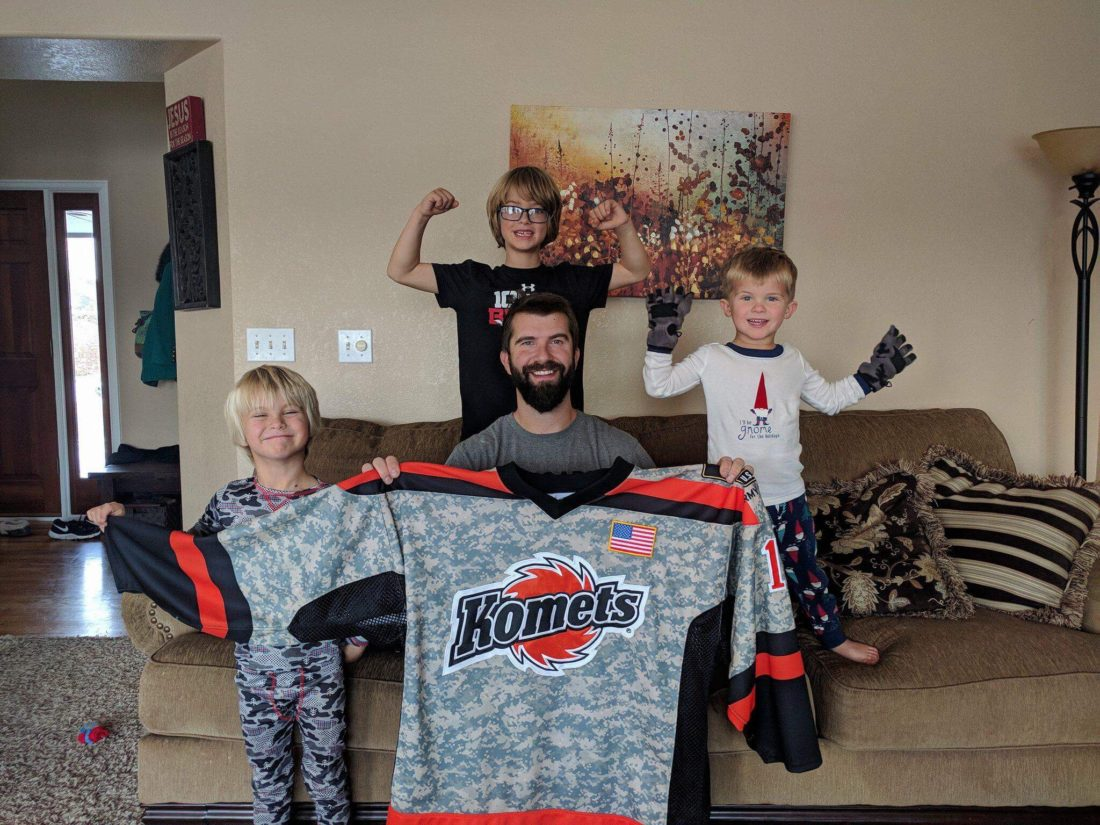 Former Komets defenseman Jake Pence and three of his four sons with the jersey he received from Bill Oberg and Sue Hansen. (Courtesy photo.)