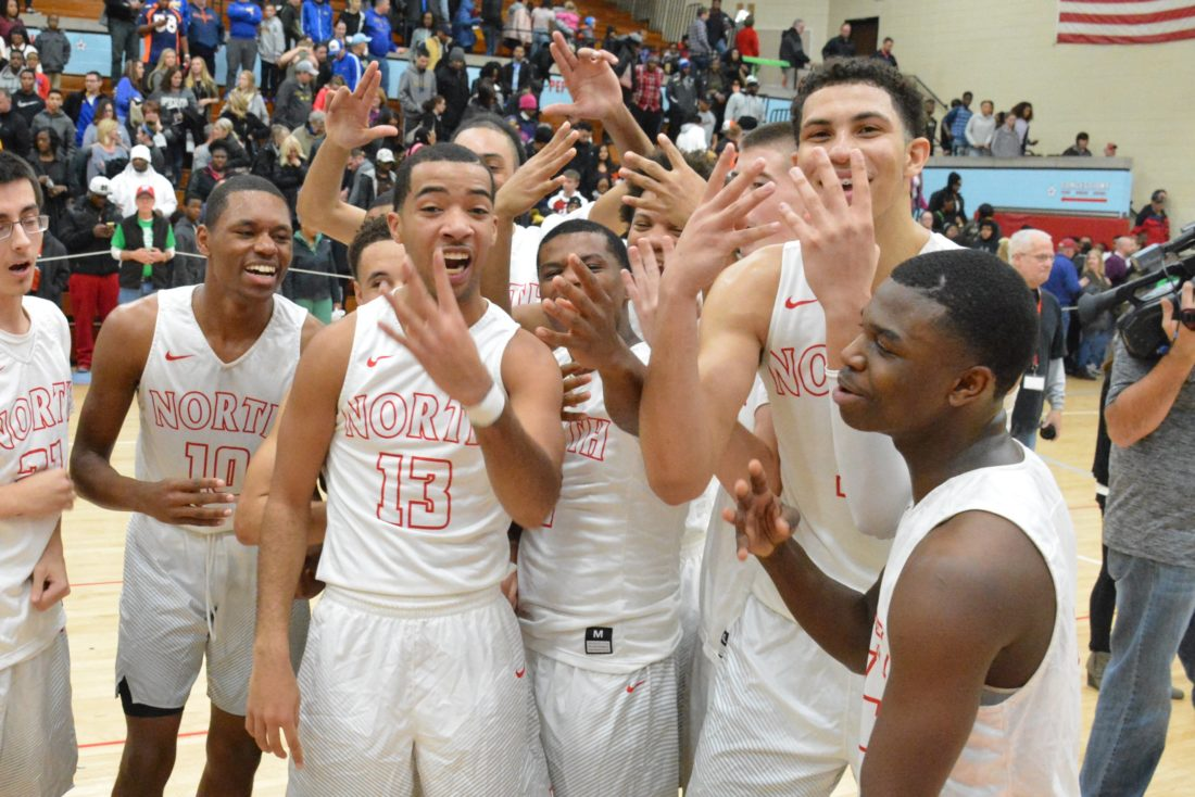 Members of the North Side boys basketball team hold up four  fingers to represent the school's fourth straight SAC Holiday Tournament on December 29, 2016 at  Wayne High School. (Photo by Dan Vance of The News- Sentinel)