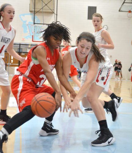 North Side's Nya Coleman (left) and Bishop Luers' Dori Javens battle for a loose ball in Wednesday's opening game of the 2017 SAC Holiday Tournament. (Photo by Dan Vance of news-sentinel.com)
