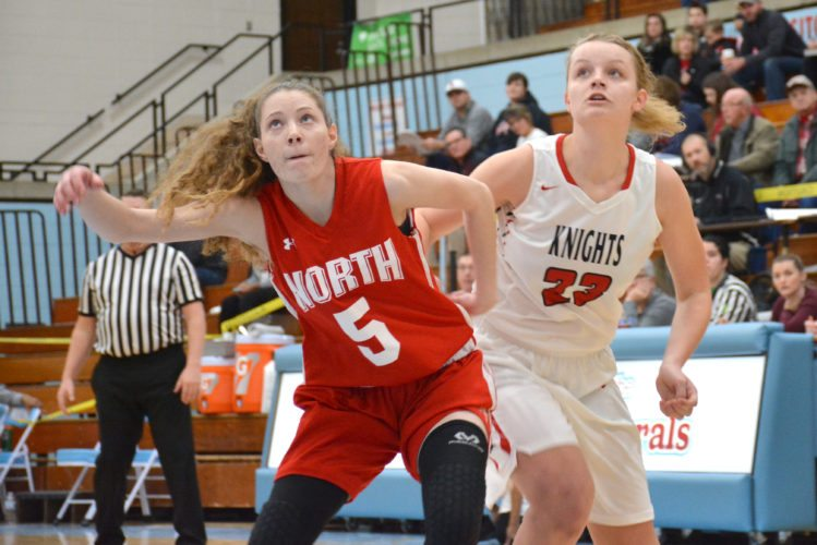 North Side's MaKyla Wilchar and Bishop Luers' Kathryn Knapke fight for rebond positioning during Wednesday's opening game of the SAC Holiday Tournament. (Photo by Dan Vance of news-sentinel.com)