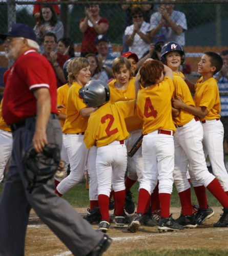 Fort Wayne Cardiology players mob McLean Trieglaff at home plate after he hit a home run to help his team win the 2008 Little League city tournament championship at St. Joe Little League's ball park. (news-sentinel.com file photo)