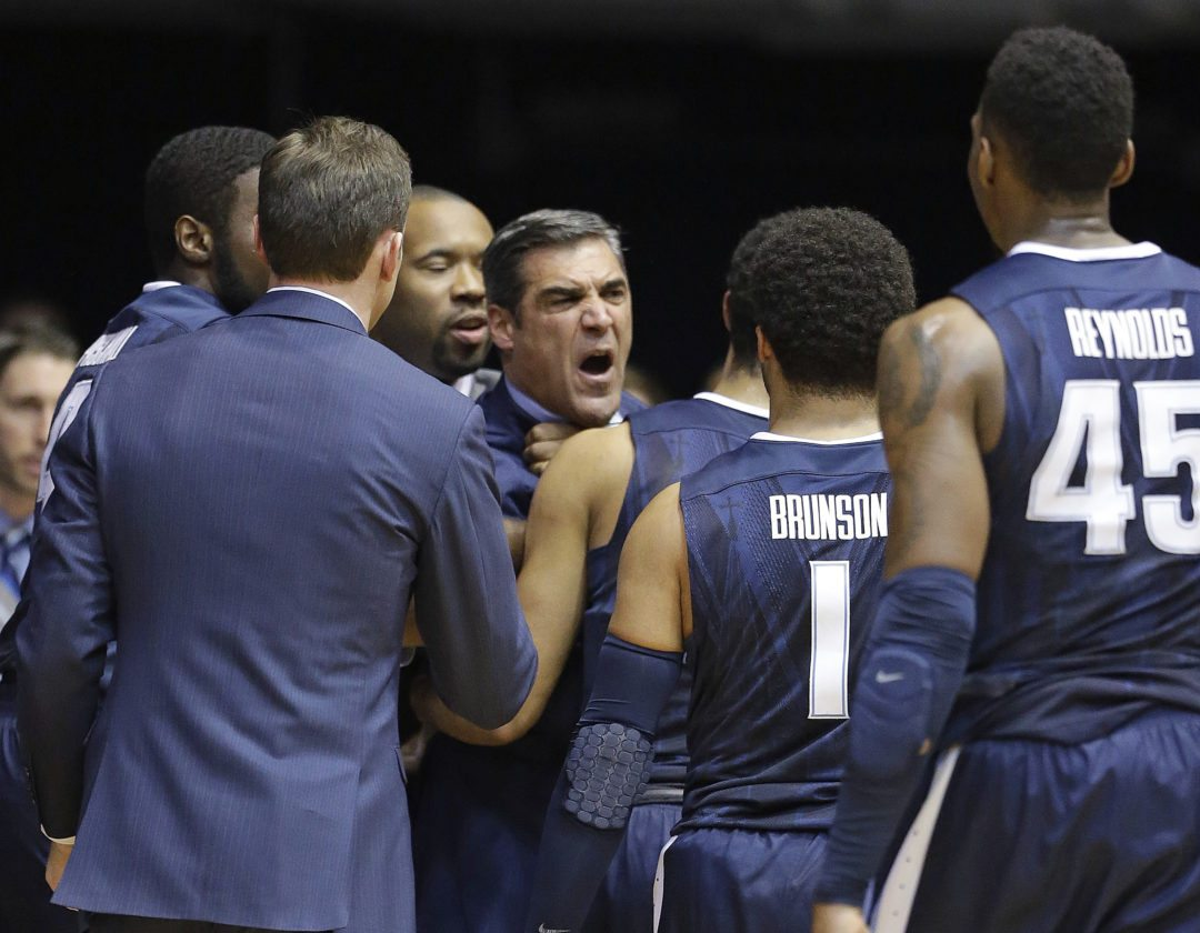 Villanova men's basketball coach Jay Wright is restrained by players after receiving a technical foul in the first half of a game last season against Butler in Indianapolis. (By The Associated Press)