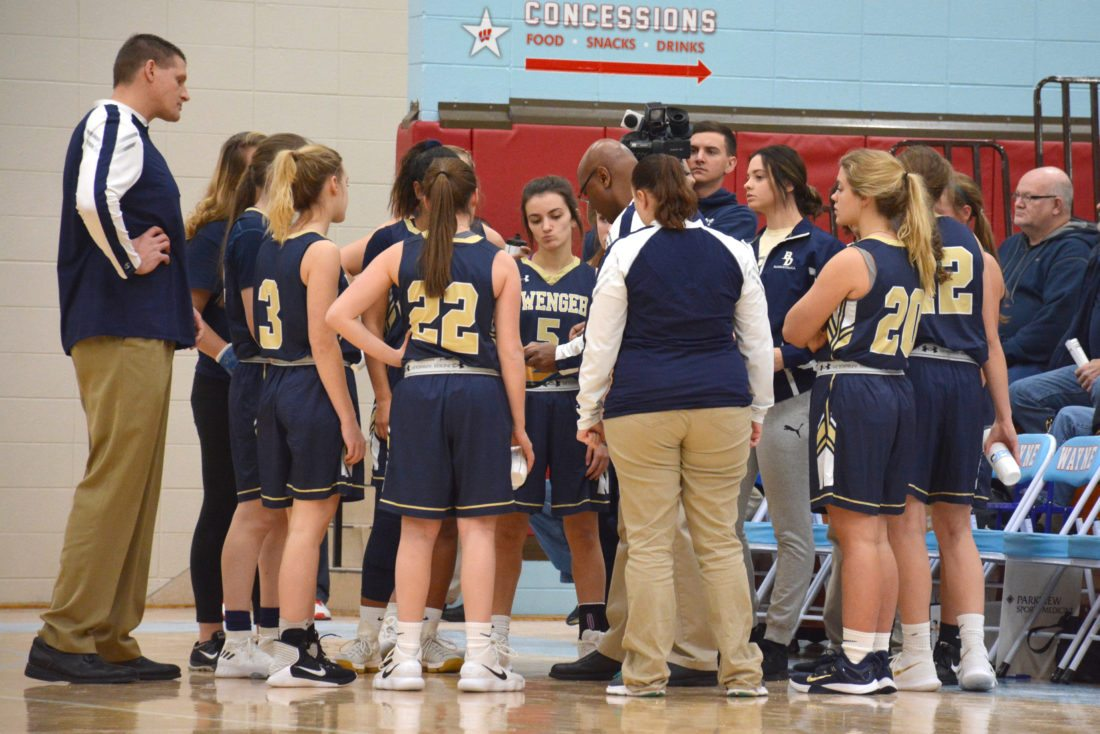 Bishop Dwenger coach Cleveland Inge talks with his team during a timeout on Thursday. (Photo by Dan Vance of news-sentinel.com)