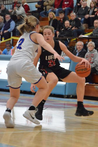 Bishop Luers sophomore Lydia Reimbold looks to find her way by the defense of Homestead's Kara Gealy in the first half Thursday. (Photo by Dan Vance of news-sentinel.com)