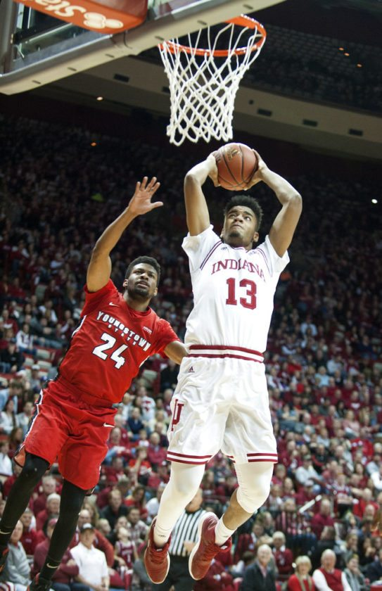 Indiana forward Juwan Morgan (13) shoots over Youngstown State guard Cameron Morse (24) during the second half of a game in Bloomington Friday. (By The Associated Press)