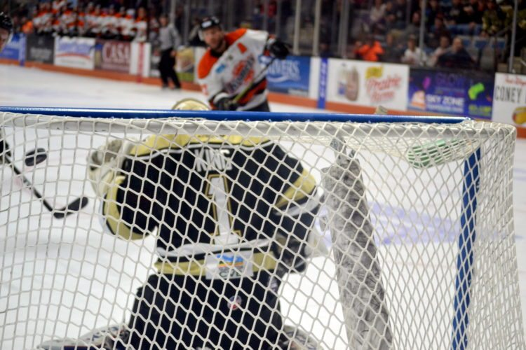 Shawn Szydlowski scores the Komets' fourth goal off a 2-on-1 late in the third period. (By Blake Sebring of News-Sentinel.com)