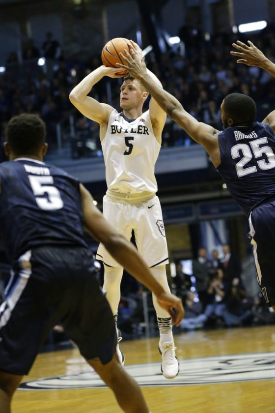 Butler guard Paul Jorgensen (5) shoots in front of Villanova defenders Phil Booth (5) and Mikal Bridges (25) in the first half of a game in Indianapolis Saturday. (By The Associated Press)