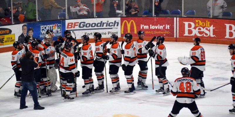 The Komets rally around goaltender Michael Houser after Sunday's 3-0 win over arch-rival Toledo before a sellout crowd of 10,479 at Memorial Coliseum. (By Blake Sebring of News-Sentinel.com)