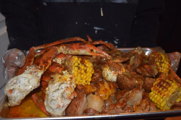 Hobo's Bar & Grill, a family-friendly restaurant at 2701 W. Jefferson Blvd., has seafood dinners that include the Alaskan king crab platter, which can also come with lobster or crayfish. (Photo by Lisa M. Esquivel Long of News-Sentinel.com)