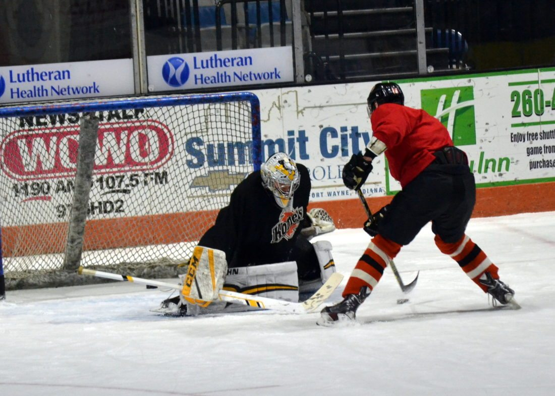 Komets center Justin Hodgman shoots on new goaltender Sean Maguire during practice at Memorial Coliseum this morning. (By Blake Sebring of News-Sentinel.com)