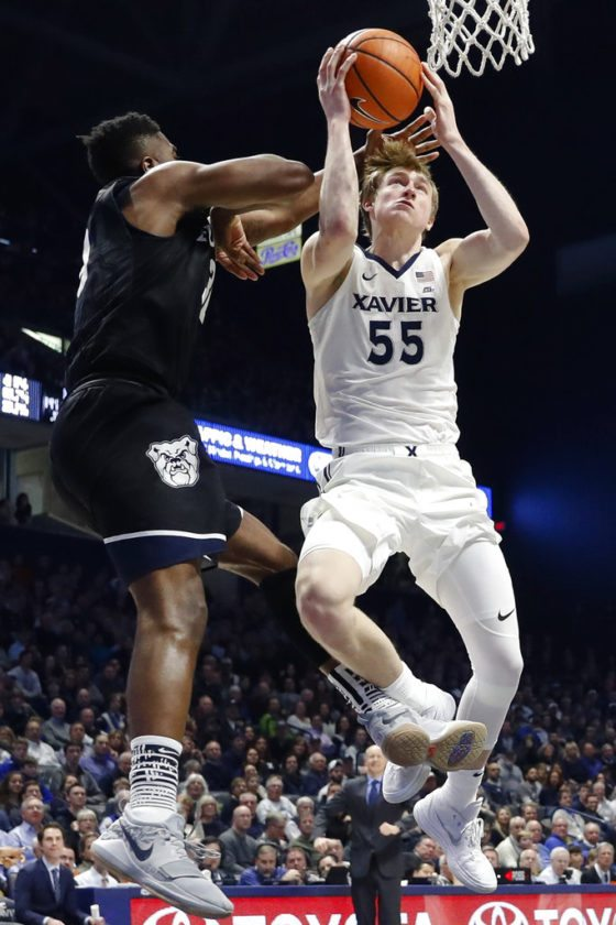 Xavier's J.P. Macura (55) shoots against Butler's Kelan Martin (30) in the second half of a game Tuesday in Cincinnati. Xavier won 86-79. (By The Associated Press)