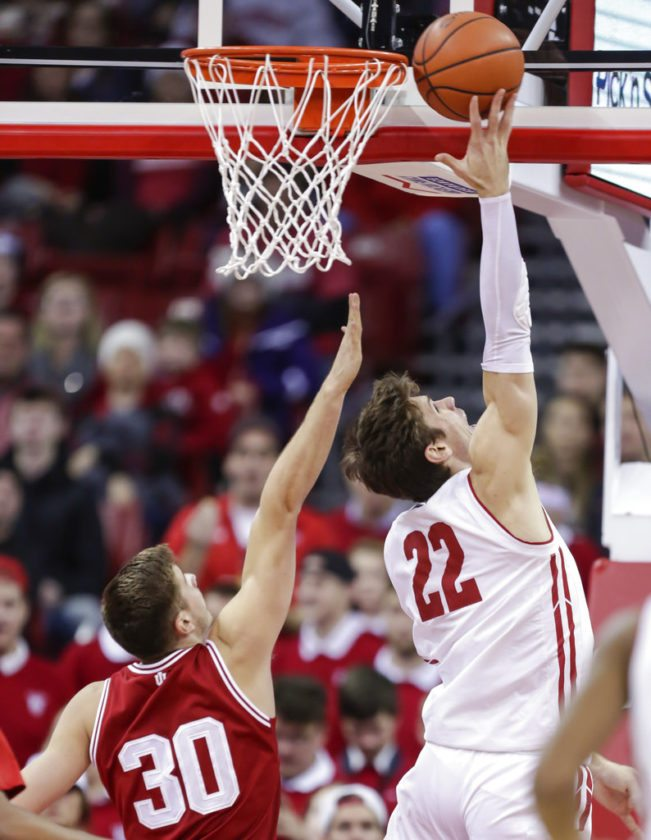 Wisconsin's Ethan Happ (22) shoots against Indiana's Collin Hartman (30) during the first half of a game Tuesday in Madison, Wis. (By The Associated Press)
