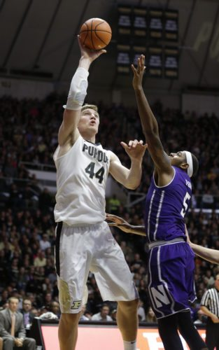 Purdue center Isaac Haas (44) shoots over Northwestern center Dererk Pardon (5) in the second half of a game last month in West Lafayette. (By The Associated Press)