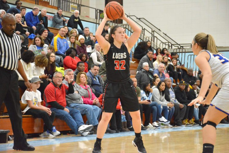 Bishop Luers' Libby Bierbaum looks for a pass during the Knights' win over Homestead on December 28 at the SAC Holiday Tournament. (Photo by Dan Vance of news-sentinel.com)
