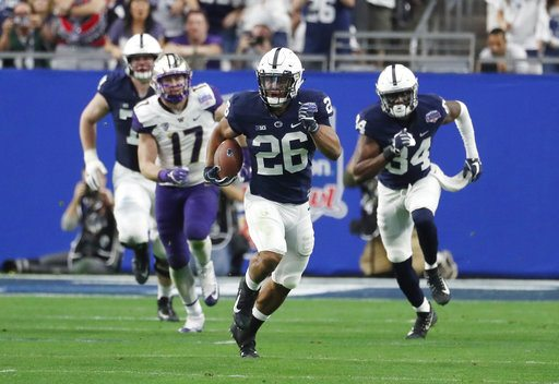 Penn State running back Saquon Barkley (26) against Washington during the Fiesta Bowl last Saturday in Glendale, Ariz. (Photo by the Associated Press)