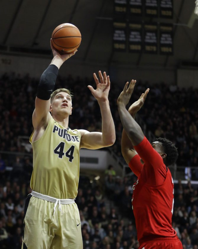 Purdue's Isaac Haas shoots over Rutgers' Shaquille Doorson during the second half of a game Wednesday in West Lafayette. (By The Associated Press)