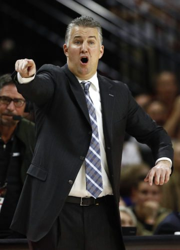 Purdue men's basketball coach Matt Painter directs his players in the second half of a game against Maryland in College Park, Md. earlier this season. (By The Associated Press)