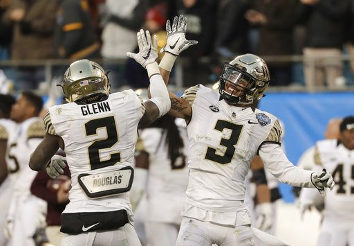 Wake Forest's Jessie Bates III (3) and Cameron Glenn (2) celebrate in the closing seconds of the second half of the Belk Bowl NCAA college football game against Texas A&M in Charlotte, N.C., Friday, Dec. 29, 2017. Wake Forest won 55-52. (AP Photo/Chuck Burton)