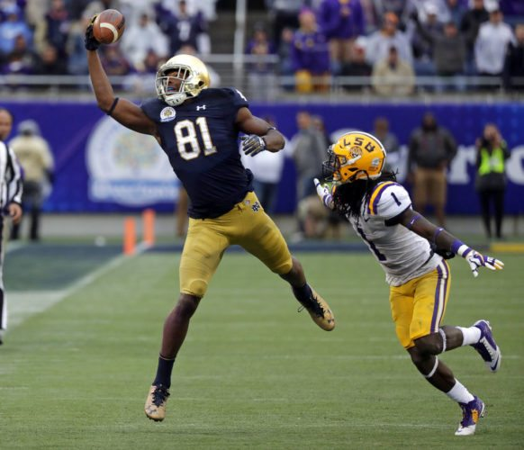 Notre Dame wide receiver Miles Boykin (81) makes a one handed catch in front of LSU defensive back Donte Jackson (1) for a 55-yard game winning touchdown during the second half of the recent Citrus Bowl game in Orlando. Notre Dame won 21-17. (By The Associated Press)