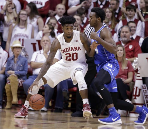 Indiana center De'Ron Davis (20) drives on Duke forward Wendell Carter Jr (34) during the first half of a game earlier this season in Bloomington. (By The Associated Press)