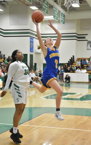Junior Kara Gealy of Homestead goes to the basket as South Side's Taniece Chapman looks on during Friday's game. (By Justin Kenny of news-sentinel.com)