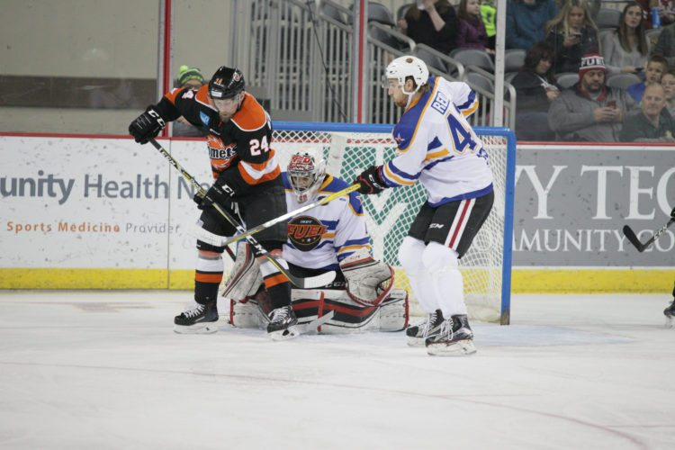 Komets center Dennis Kravchenko screens Indy goaltender 	Marcoux, Etienne during the first period Friday night. (Photo courtesy of Whiteshark Photography.)